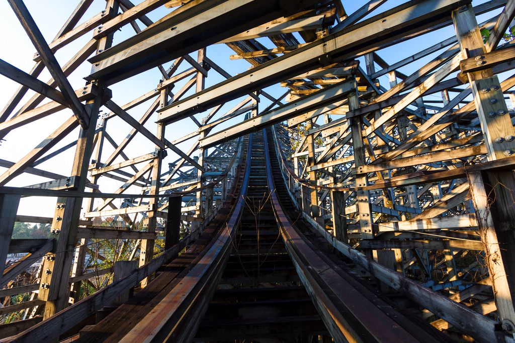 Climbing to the top of an abandoned wooden roller coaster