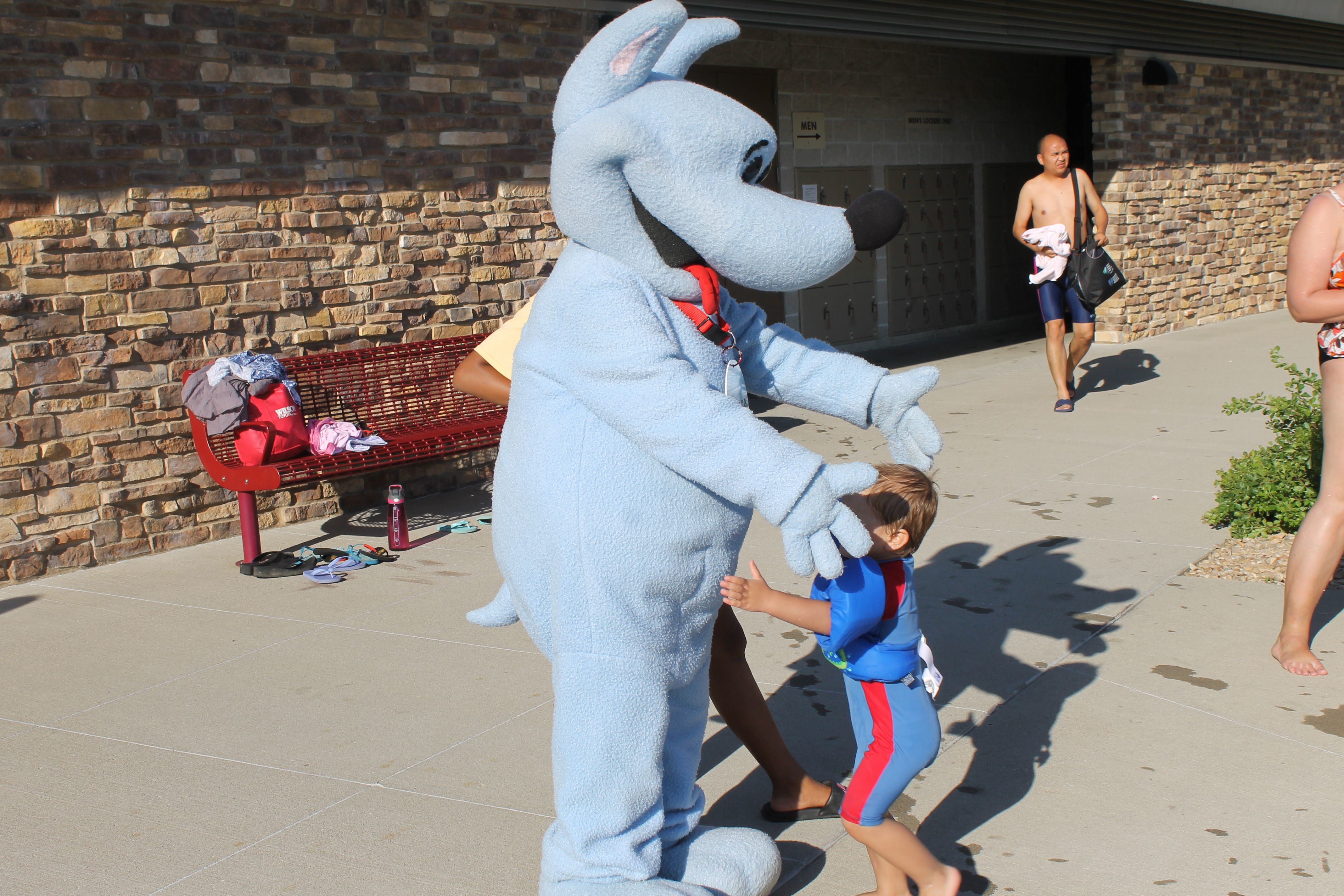 Smyles The Ames Public Library S Mascot Extends His Arms For A Hug During National Summer Learning Day At The Furman Aq Summer Learning Pantsuit Public Library