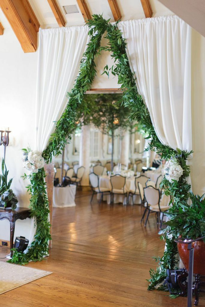 chic wedding reception, love the draping!  Photo: Watson-Studios