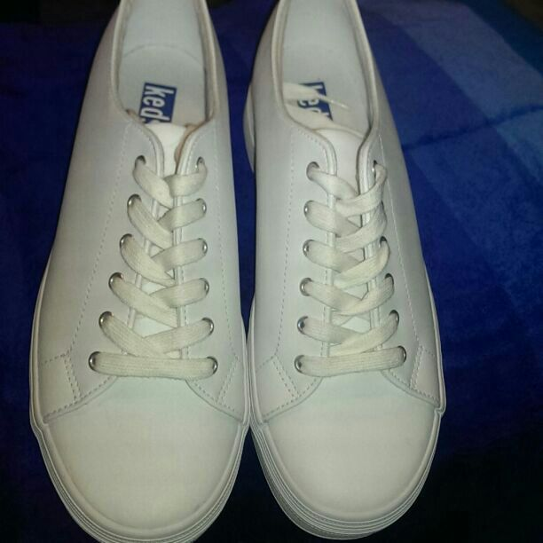 "Bought and went unused. BRAND NEW never worn Keds. Pictures show the great condition of the shoes. White leather double ""dutch"" shoes. ($50 value) $25 + free shippinng!! $32 Final Price!"