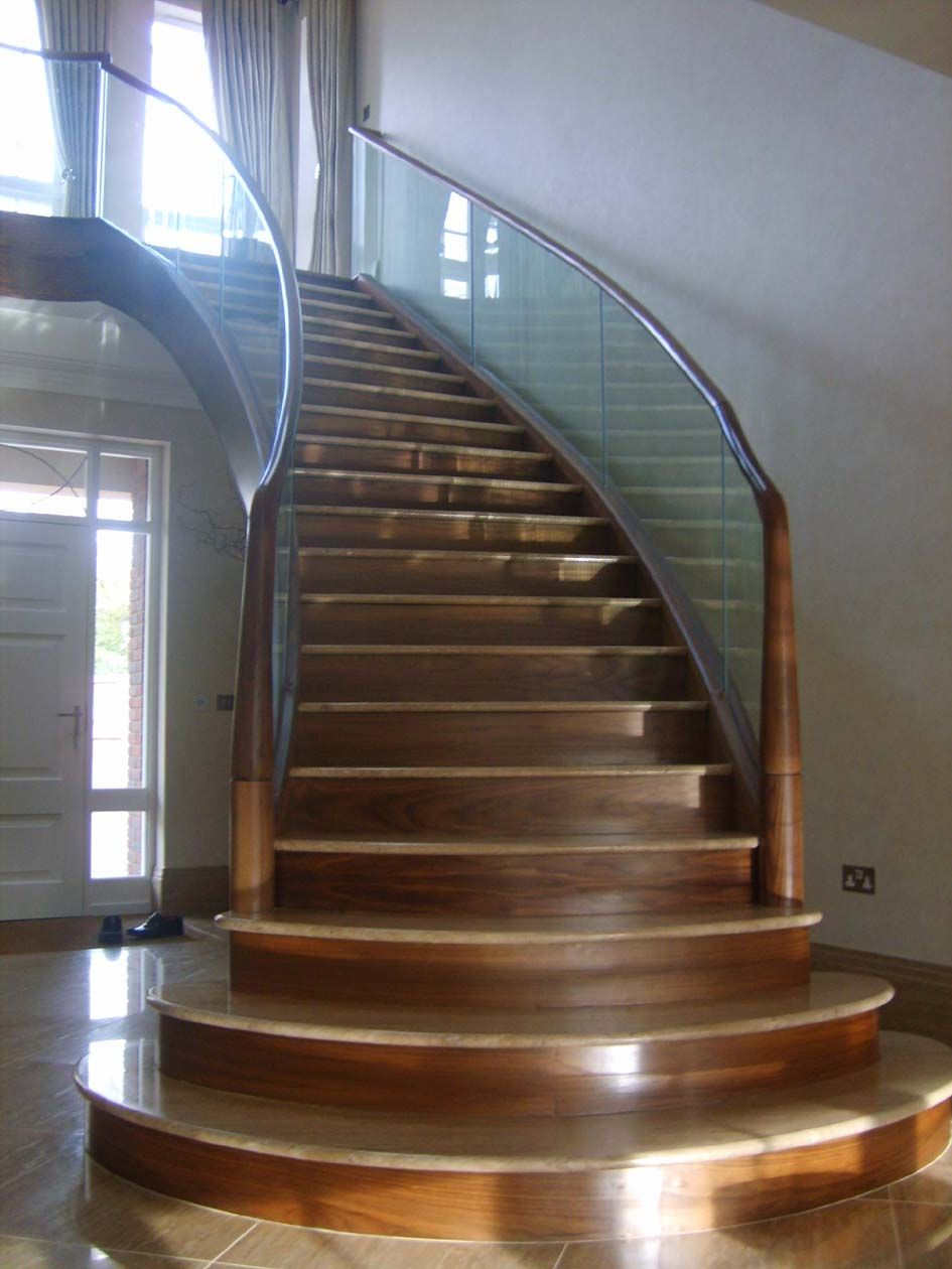 Best Fabricated Mild Steel Helical Staircase Clad In Walnut 640 x 480