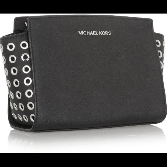Michael Kors Brand new is a messenger bag/ satchel. New with tags. Studs on side goes with everything! Michael Kors Bags