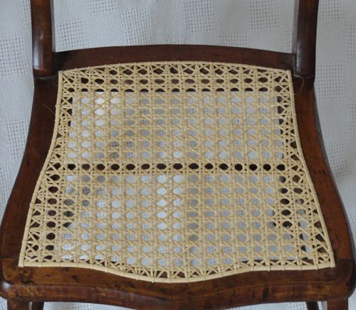 A Completely Rewoven Strand Cane Chair Seat