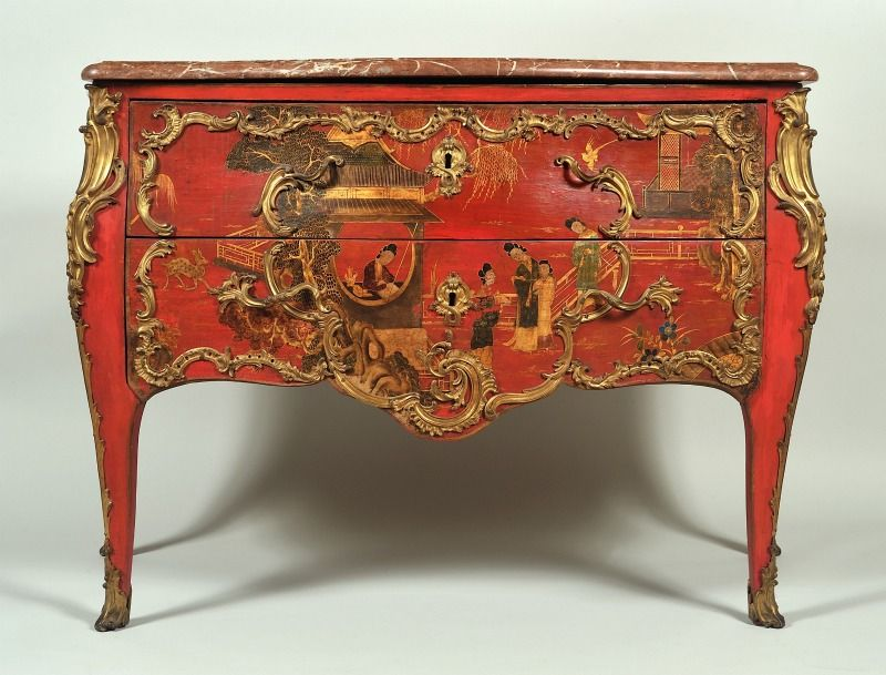 A french commode in vivid red lacquer  with chinoiserie panels, 18th century, Louis XV style