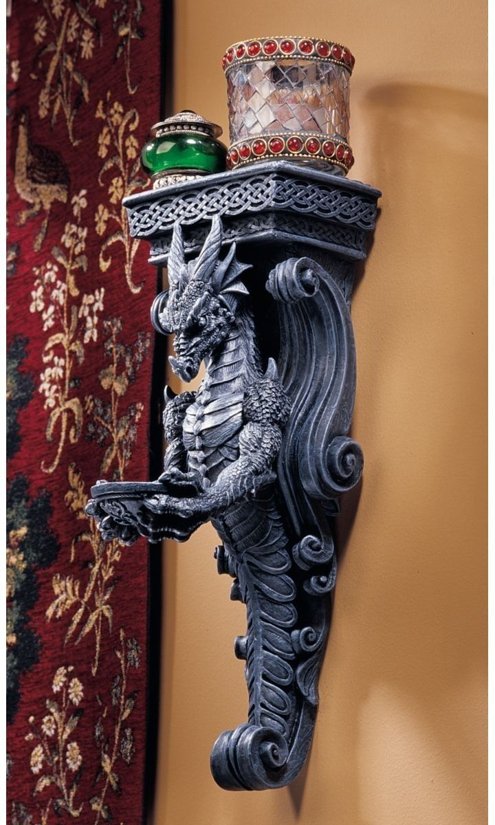 Bring the Gothic-style architecture of an award-winning sculptor into your own castle! ; Whether hung individually or lining a corridor, our exclusive dragon caryatid can be mounted flush to a ceiling, or lower to frame a tapestry or favorite artwork. the artist intricately sculpted his three-dimensional dragon with claws and fangs fully bared. Our foot-tall, quality designer resin sculptures are easily mounted indoors or out.   See alternate views for details. 54.95