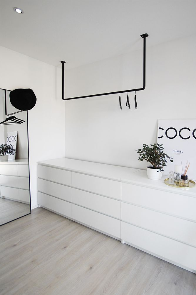 Photo of open Scandinavian style closet, black and white