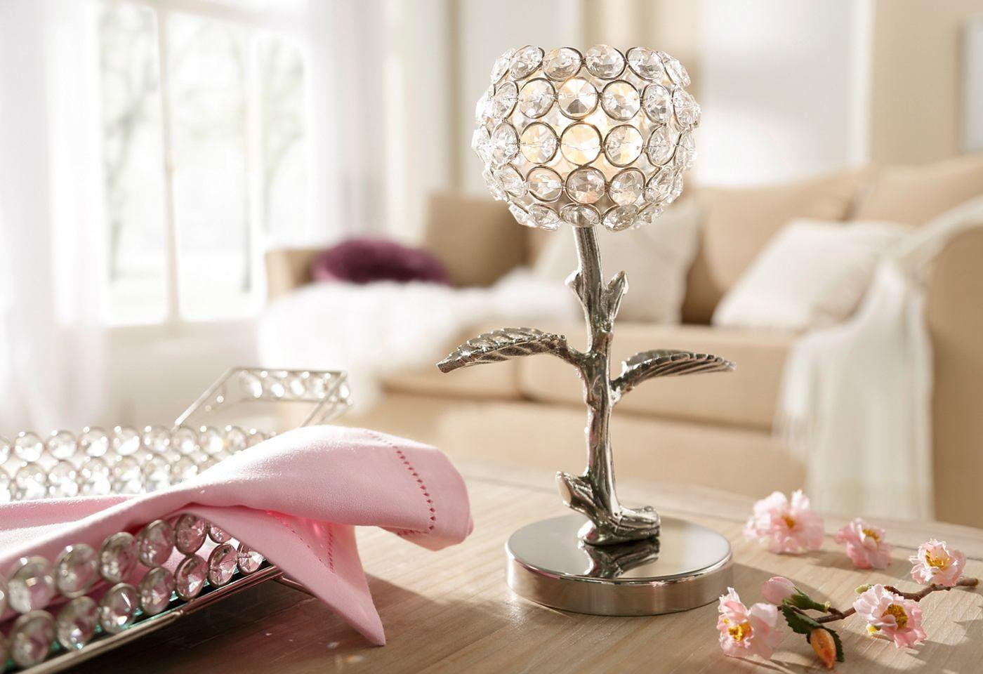 Artikeldetails:  Eleganter Kerzenhalter, Für ein Teelicht,  Maße:  Maße (Ø/H): 10/23,5 cm,  Material/Qualität:  Kristallglas und Aluminium,  ...