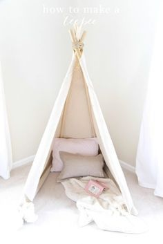 1 hour easy no sew teepee tutorial. Get the easy DIY details of this wigwam play tent that's a fun addition for a bedroom or playroom!