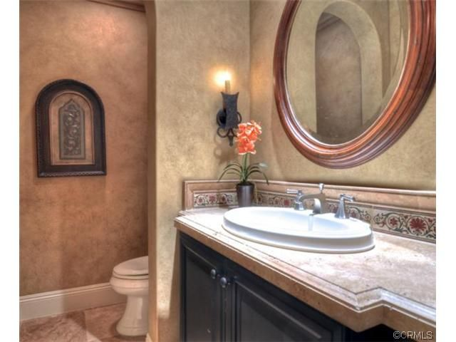 Mediterranean Powder Room With Faux Painted Walls