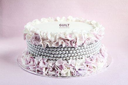 Soft pink and gray wedding cake   ~ the  pearls were   painted with edible silver paint