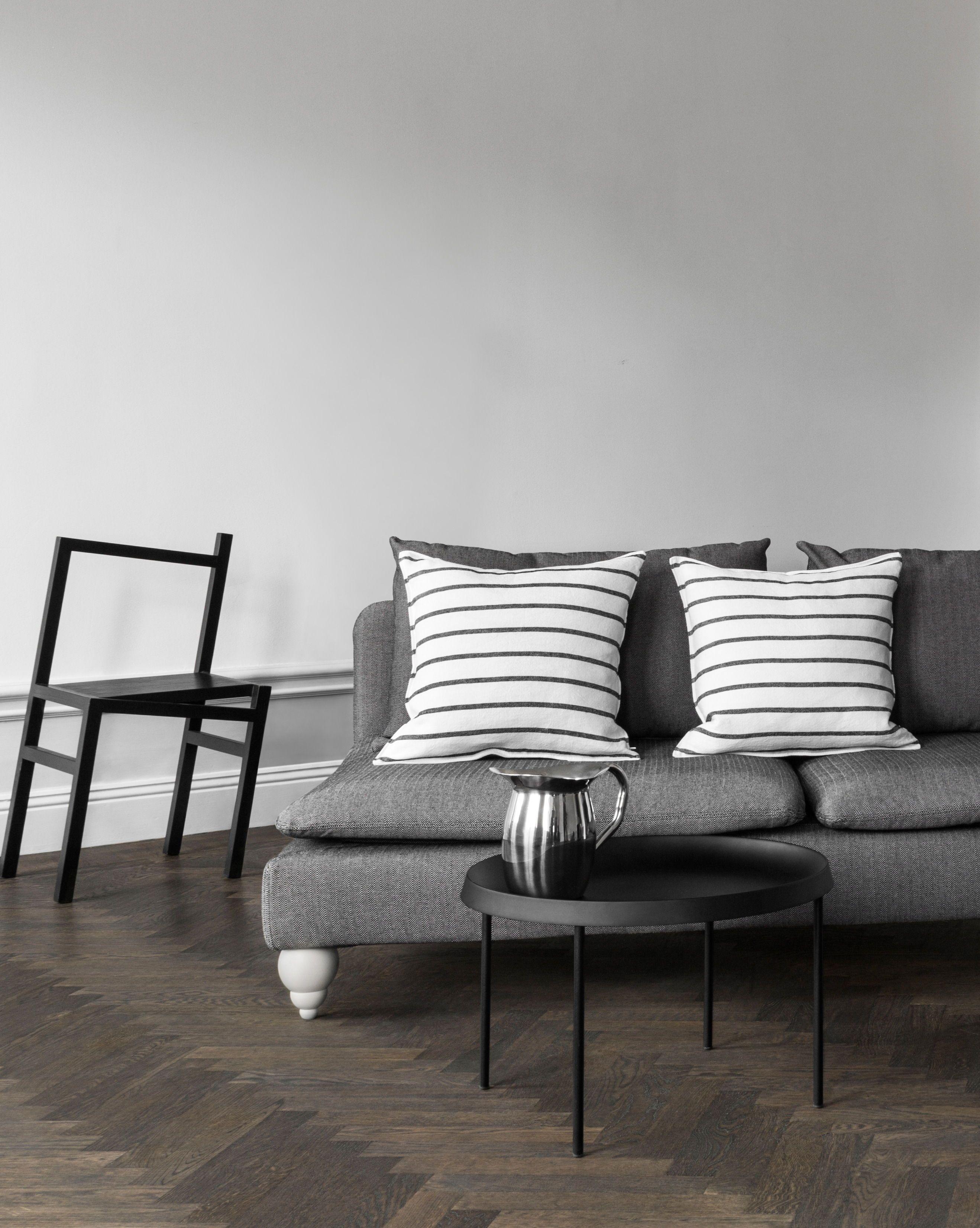 Sleek Minimalist Scandinavian Living Room With A Sophisticated Monochromatic Colour Palette Dark Herringbone Floors And Gr Furniture Ikea Sofa Furniture Legs