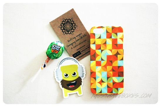 October 2013 Phone Case of the Month: iPhone 4/4s Package. Each phone case was nicely packaged in a small branded drawstring knapsnack. Also included in the sack was an inspirational card that described the design, a cool sticker and a piece of candy. Price: USD $10.00/month -- #subscriptionbox #phonecase #iphone #design #phonecaseofthemonth #technology #smartphone
