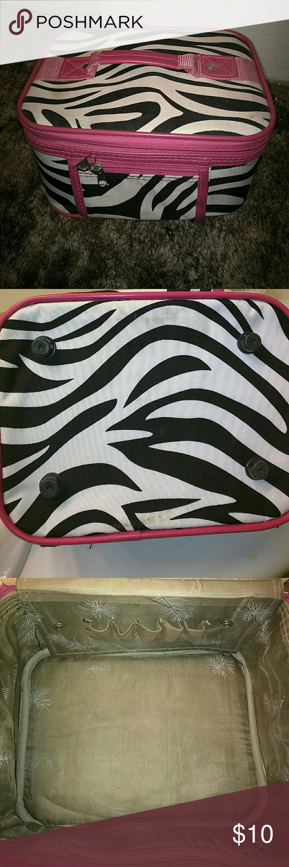 Makeup bag Zebra print makeup bag with zipper. Small pocket in the front with zipper. Mirror inside, slots to hold small items. Very small cleaning needed. 9 and a half by 7 and a half (measurements) Bags Cosmetic Bags & Cases