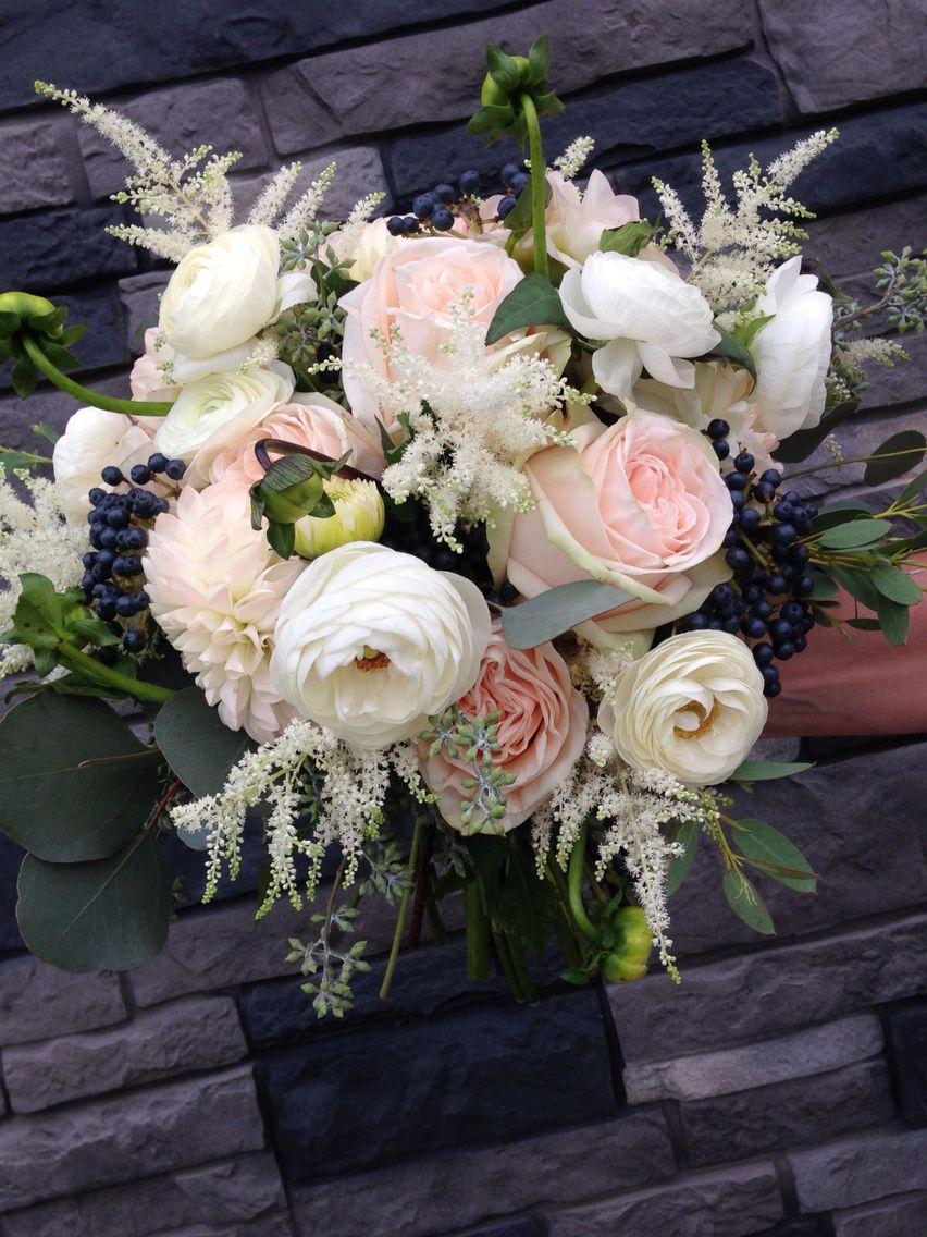 Bridal bouquet of garden spirit roses, ranunculus, blush