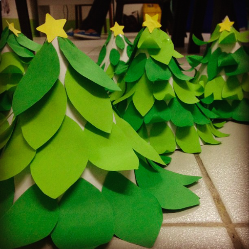 Christmas Tree Art  Make a cone from poster board (secure with tape/staple). Cut out leaves and stick around the cone staring from the bottom going up. Stick any topper when done!  This is actually the output of my 2nd grade art class. I had them cut and curl their leaves on their own to add challenge. This might be a little tedious for younger kids because of the overlapping layers.