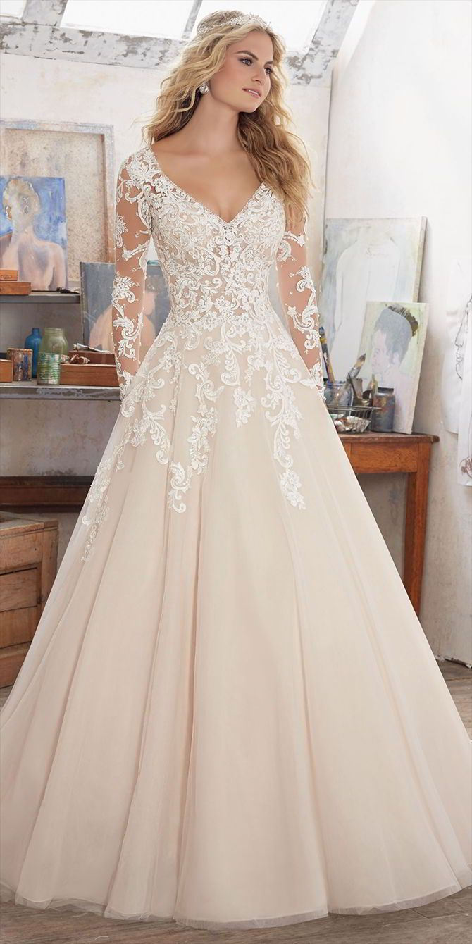Nagy Menyasszonyi Ruhák · Long Sleeve Wedding Dress Featuring Delicate  Crystal Beading on Bodice and Embroidered Appliqués on Tulle. d46f92b084