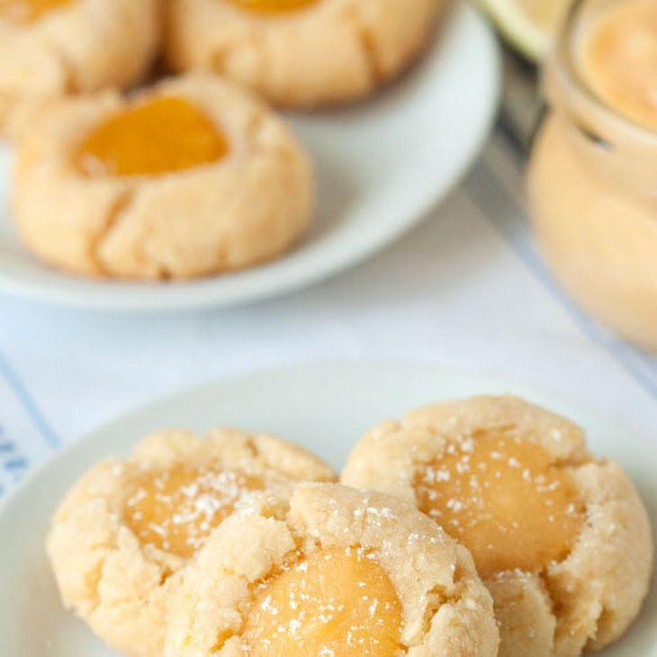 Gluten-Free Lemon Thumbprint Cookies Recipe Desserts with blanched almond flour, coconut flour, granulated sugar, baking powder, salt, unsalted butter, large eggs, lemon zest, lemon extract, lemon curd, powdered sugar