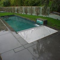 Coverstar Central Automatic Pool Cover On A Rectangle Pool With Water Features Pool Safety Covers Automatic Pool Cover Rectangle Pool