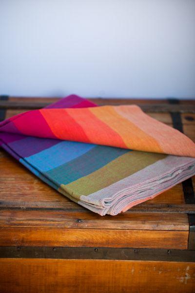 67b296dccf3 Girasol Woven Baby Wrap - Earthy Rainbow. Handmade in Guatemala using  traditional Mayan weaving techniques.