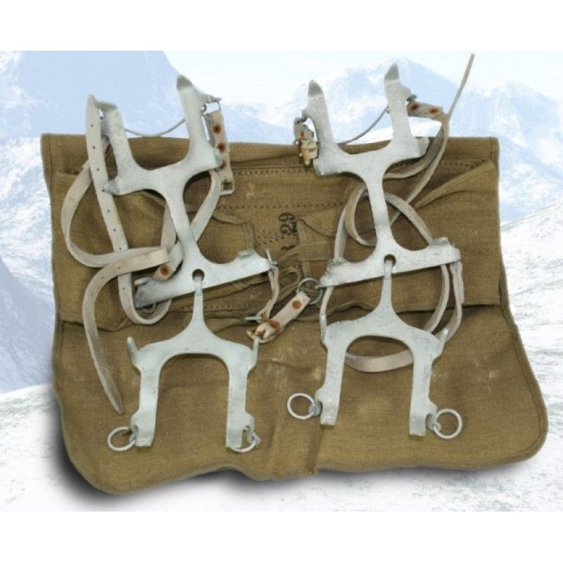 """Italian 1950 s Ice Crampons - Italian 1950's ice crampons. Used in good condition. Steel construction. Tough ice-piercing teeth """"bite"""" to ensure safety on the snow, ice. Thick leather adjustment straps attach to your boots for a custom fit. One size fits most footwear. Storage / transport bag."""