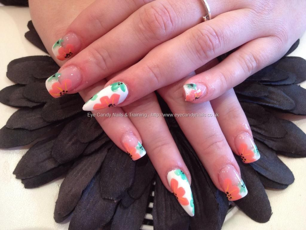 Full set of acrylic with stiletto nail on ring finger and orange and ...