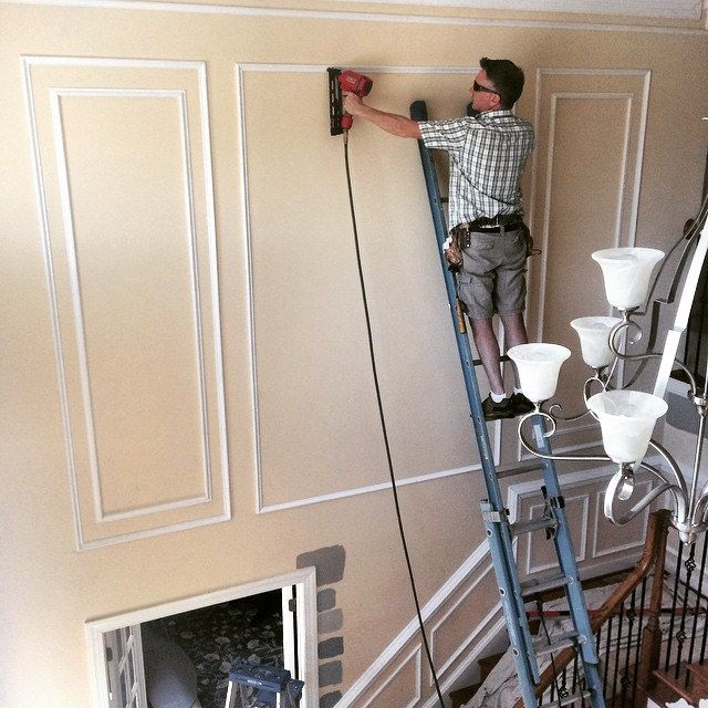 On the job shadow boxes in two story foyer richmond va - How to decorate tall walls ...