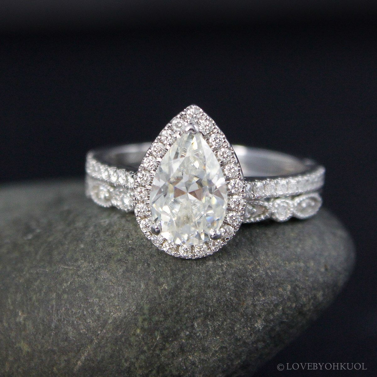 Forever one white gold vintage pear cut moissanite halo diamond