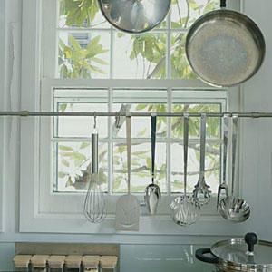 Window Space - Organize Your Kitchen - Southernliving. You can utilize the space across the window by installing tool rails or shelves.