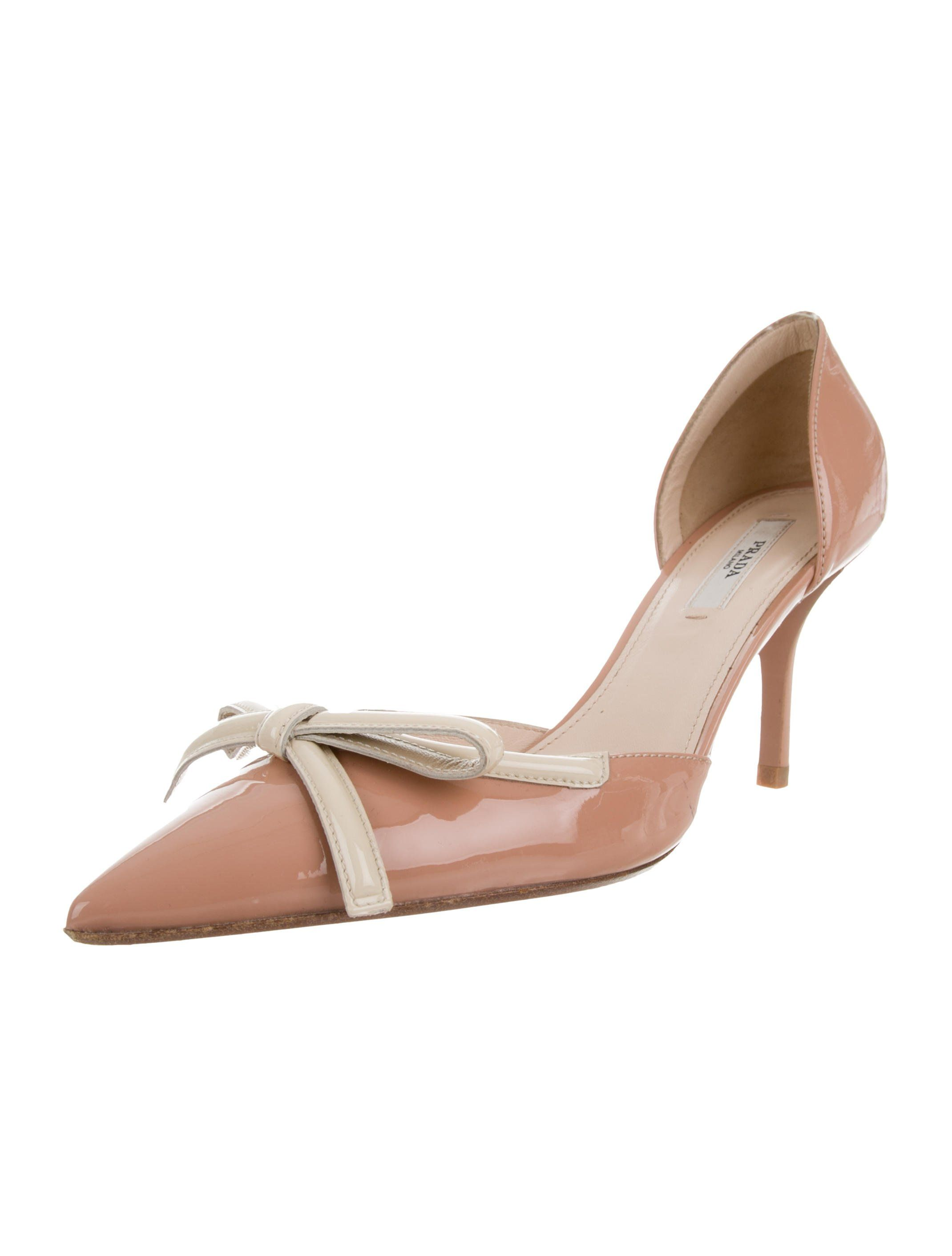 a092370689 Tan and beige patent leather Prada pointed-toe pumps with bow accents at  uppers and covered heels. Includes dust bag.