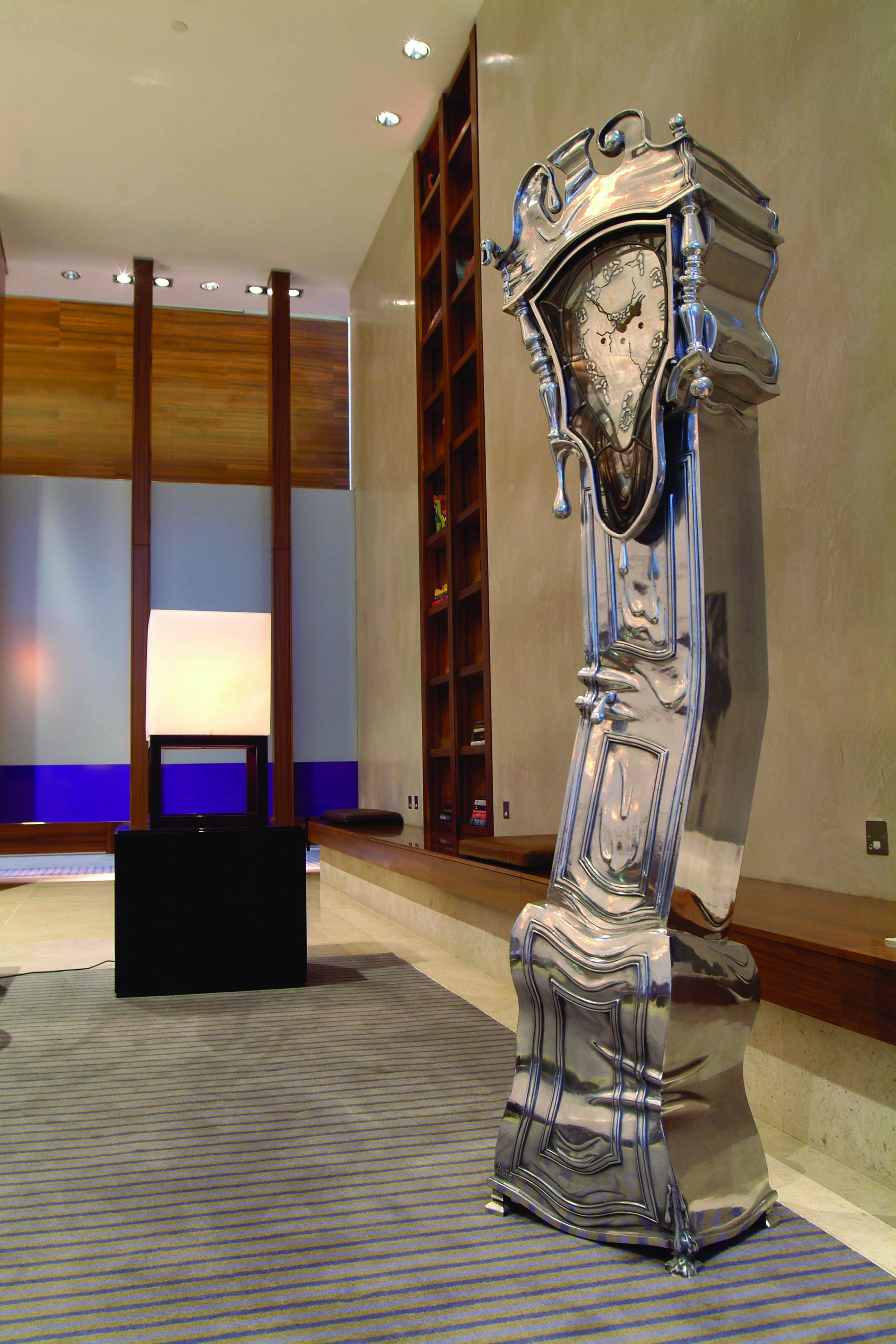 salvador dali inspired melting metal altlas grandfather clock