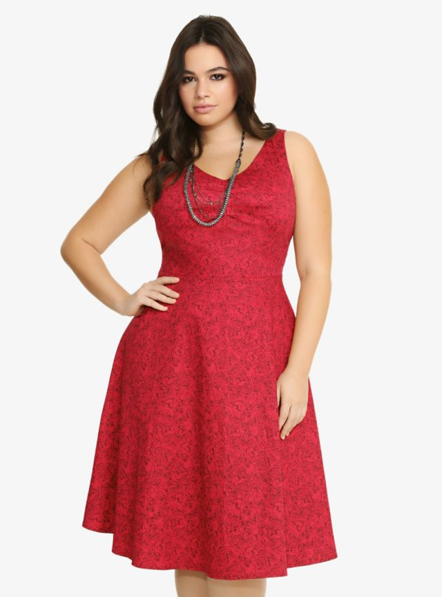 <i>Pre-order today! Estimated ship date is 1/7/15.</i><br>What a way to fire up the night! This limited edition red Disney dress combines a beautiful black rose and Minnie Mouse pattern. Don't miss this stellar Torrid exclusive A-line number that's full of stylish detail.%0A