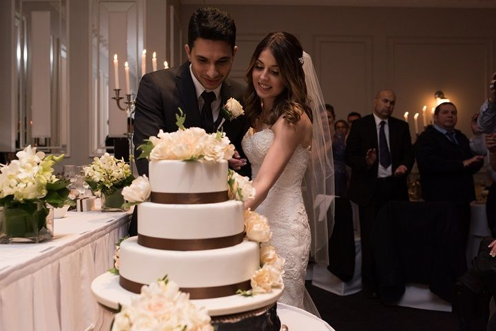 bride and groom cutting the wedding cake | itakeyou.co.uk #weddingcake #threetiers #cake