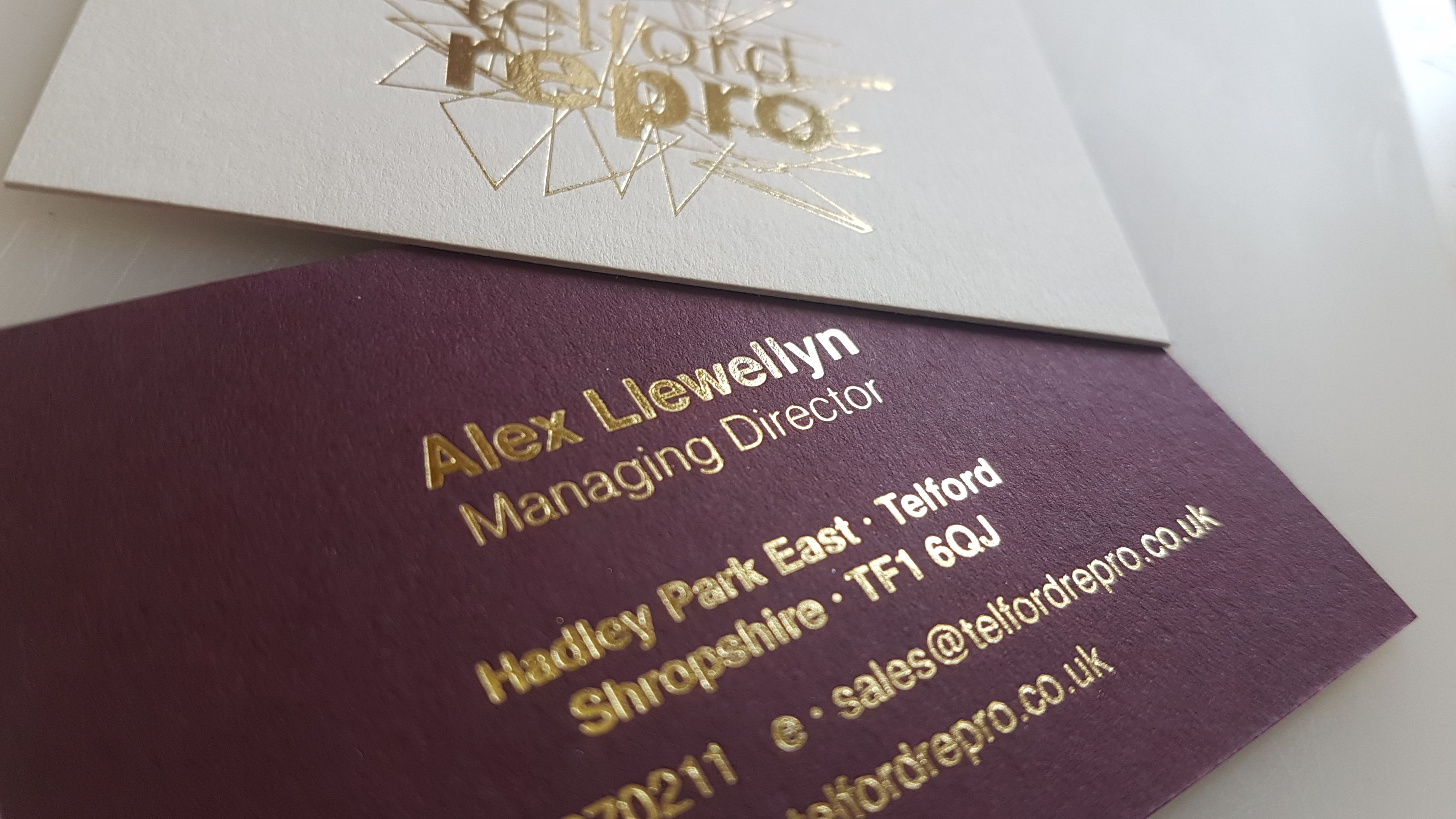 A closeup of some gold foiled business cards gold foil