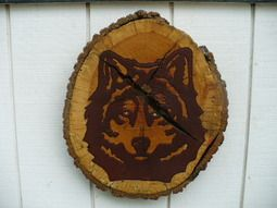 Wolf Log Art, hand carved and painted with a brown stain. Rhinestone eyes, beautiful