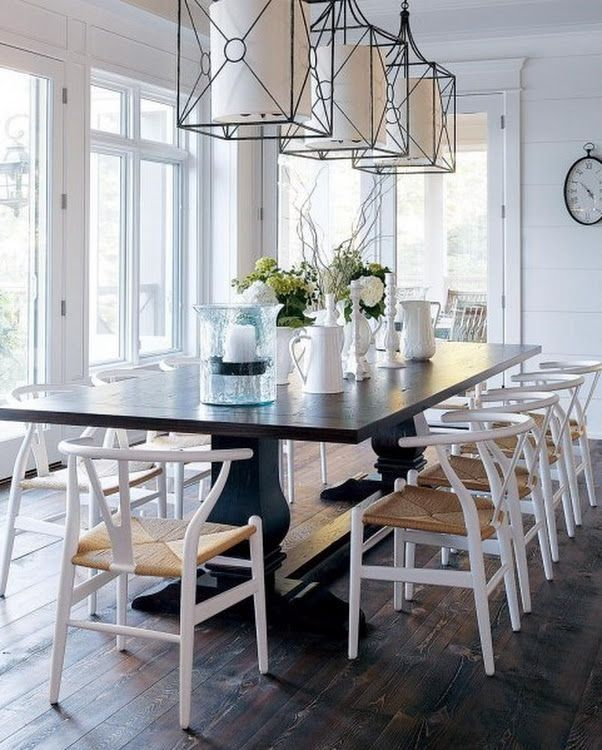 Relaxing Dining Area With A Trio Of Iron Pendant Lights Cottage Dining Rooms Dining Room Decor Rustic Nautical Dining Rooms Cottage farmhouse dining room lights