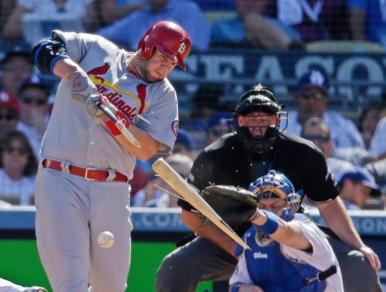 St. Louis Cardinals' Matt Adams hits a brokenbat single