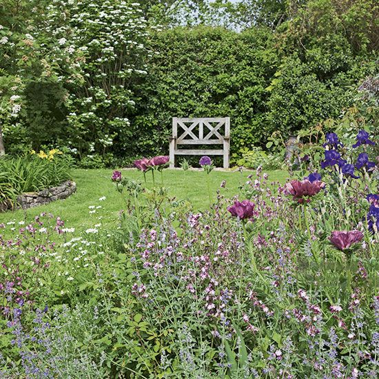 Summer country garden with bench is part of Country garden Furniture - Need country garden ideas  Take a look at this summer country garden with a bench from Country Homes and Interiors for inspiration  Find more garden design and shopping ideas at housetohome co uk