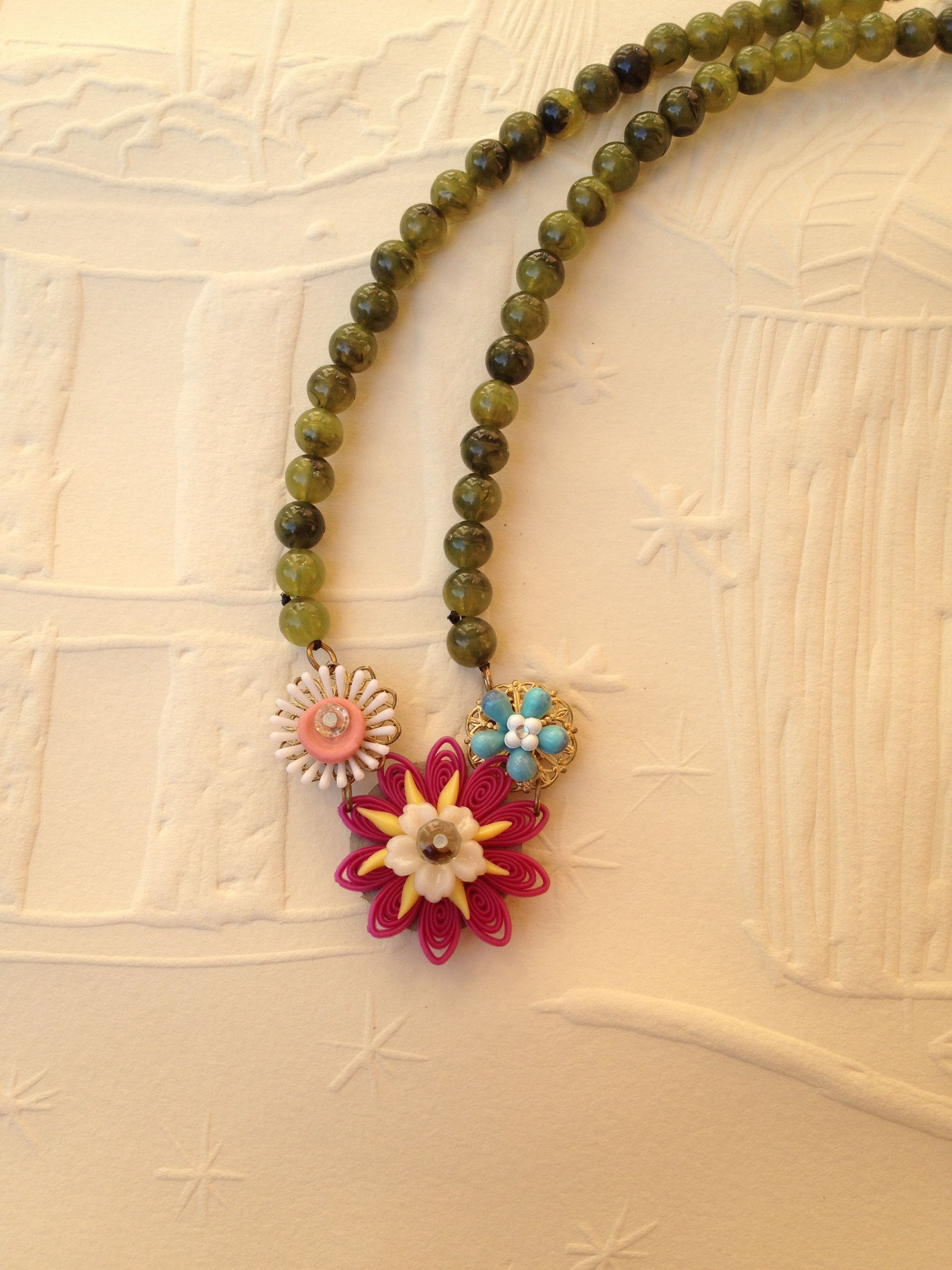 Handcrafted -with vintage lucite beads and flowers.  $65