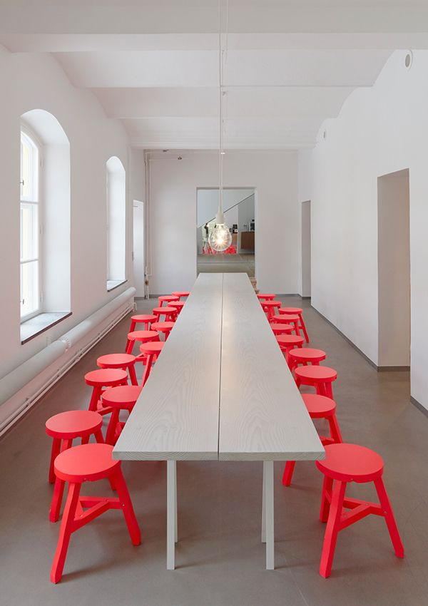 Photo of Red chairs + long tables in kitchen