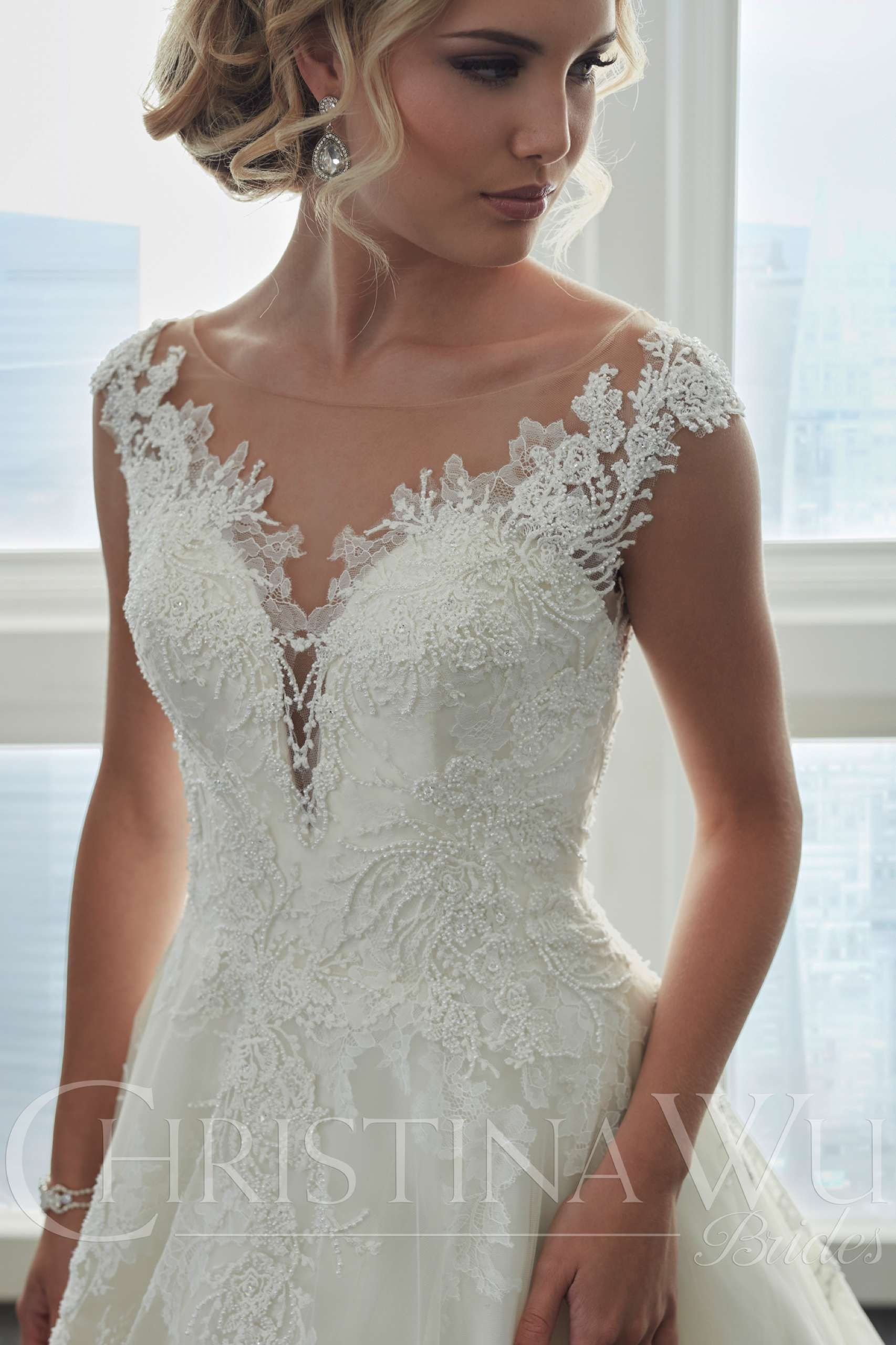 This illusion neckline aline gown has been carefully decorated
