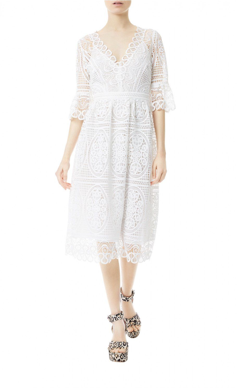 Titania Lace Sleeved Dress - Shaped from bold open macramé lace, the Titania Lace Sleeved Dress is an elegant warm-weather style underpinned by Temperley's signature bohemian undercurrent. With flared sleeves, this white summer dress features a deep v-neck, cinched-in waist and falls to a midi-hem.