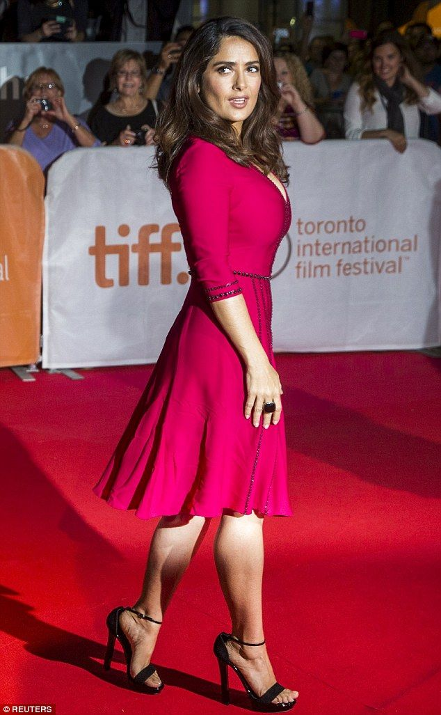 Salma Hayek, 49, shows off cleavage in low-cut ruby dress
