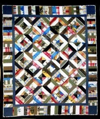 "Quilt made from Men's Clothing, everything from bathing suits to tuxedo (64"" x 73"")."