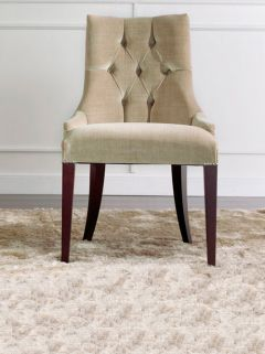 The Luxury velvet buttoned armchair is hand carved from solid beech wood with a moka satin finish. Shown here upholstered in a champagne velvet fabric with button backed and silver stud detail.