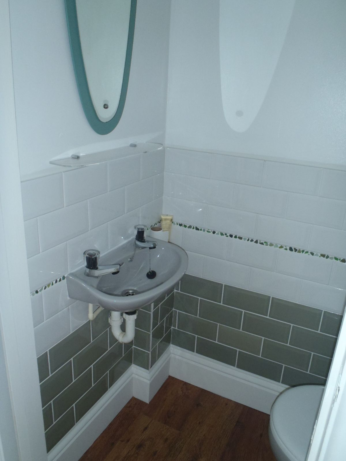 Use sea glass as mosaic tiles in a small toilet / cloakroom!