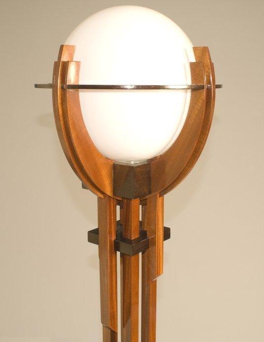 Craftsman style floor lamp with a bulbous globe light