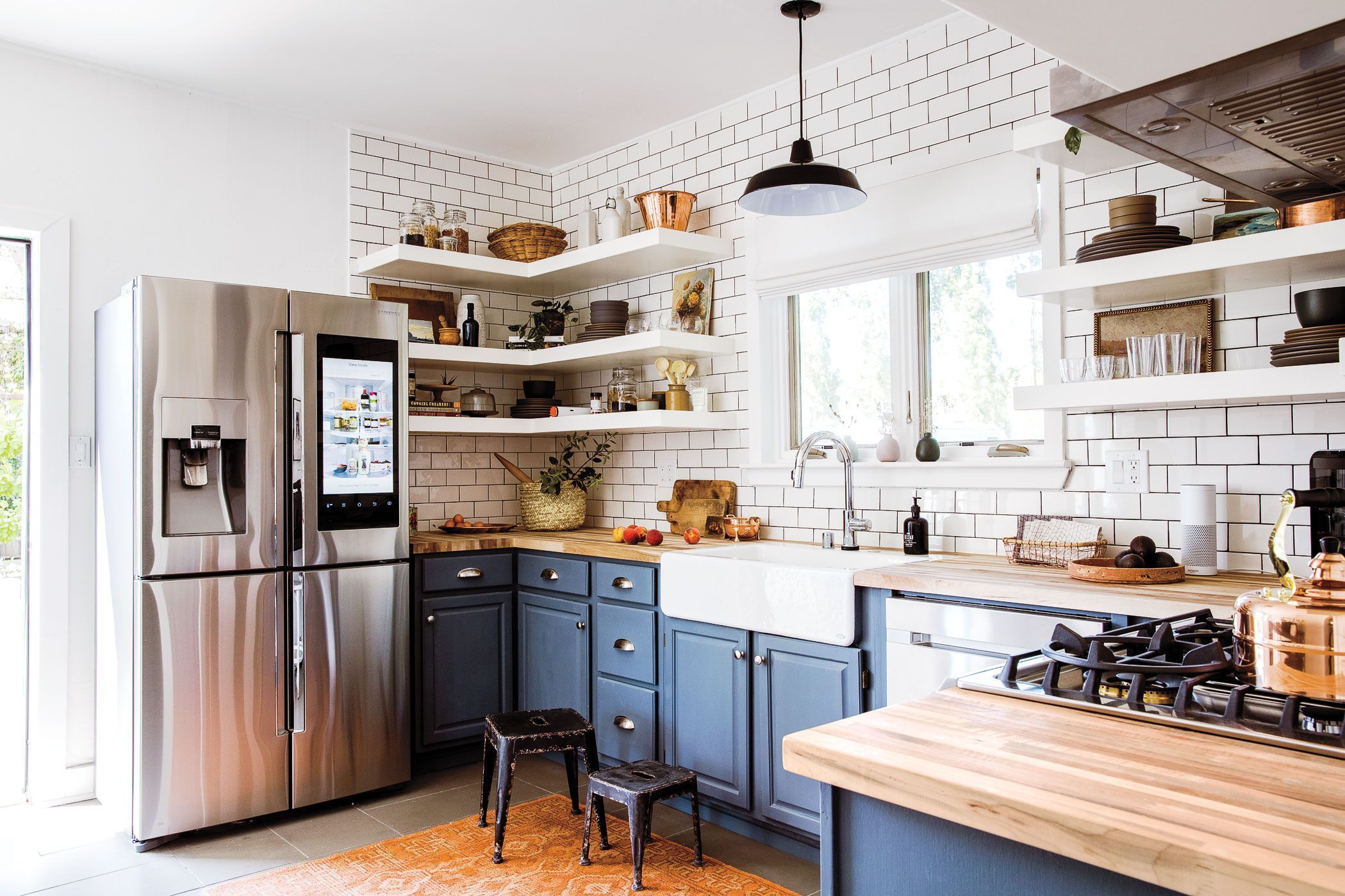 P Mccarthy Opened Up The Kitchen By Swapping Out The Upper Cabinets For White Shelves Against Counter T Kitchen Remodel Small Kitchen Design Kitchen Remodel
