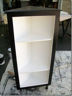 DIY corner shelf. Just what I'm looking for! And she built it for like a dollar.