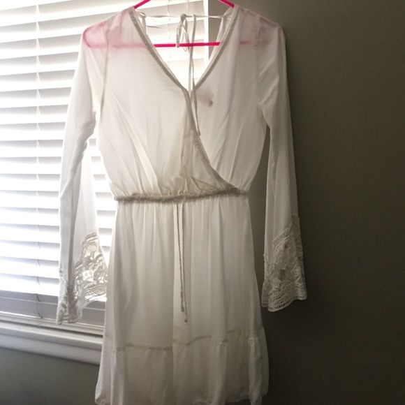 White lacy peasant dress this lightweight and whimsical dress is perfect for sunny days and walks on the beach. lace edges on the sleeves and lace decoration around the v-neck line. H&M Tops Tunics