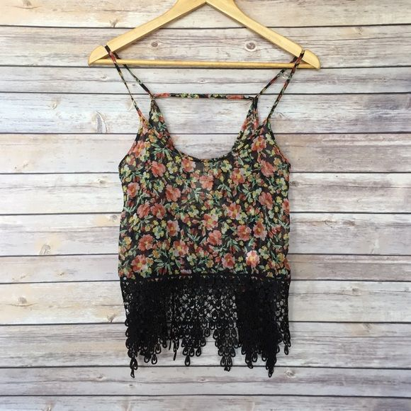 Floral Festival Top Floral sheer crop top with spaghetti straps.  Black fringe detail on the bottom.  Last picture is of the backside with the strap going across. Tops Crop Tops